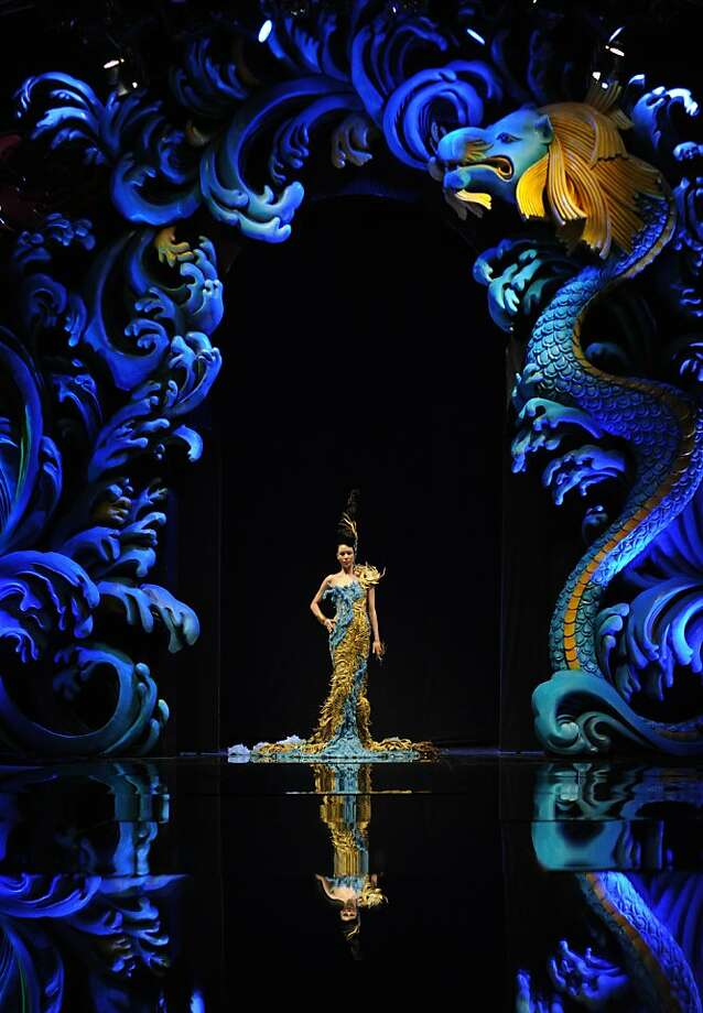 A model presents a creation by Chinese designer Guo Pei during the Asian Couture 2012 Women Fashion Week in Singapore on November 27, 2012.  AFP PHOTO/ROSLAN RAHMANROSLAN RAHMAN/AFP/Getty Images Photo: Roslan Rahman, AFP/Getty Images