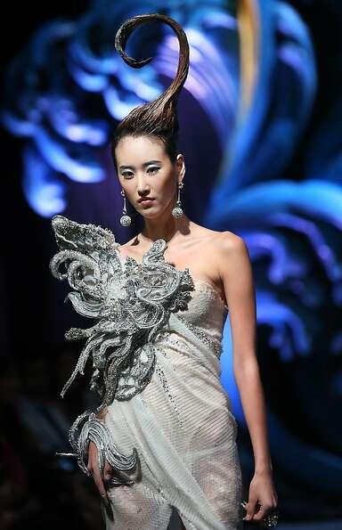 A model showcases a creation by Chinese designer Guo Pei on Tuesday Nov. 27, 2012,  in Singapore dur