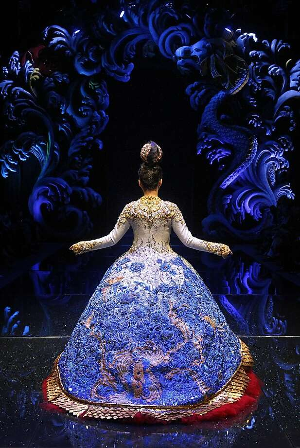 A model showcases a creation by Chinese designer Guo Pei on Tuesday Nov. 27, 2012,  in Singapore during the Asian Couture 2012 Singapore fashion show. (AP Photo/Wong Maye-E) Photo: Wong Maye-E, Associated Press