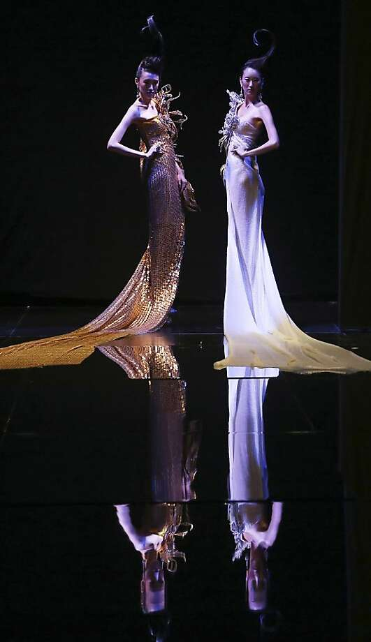 Models showcase creations by Chinese designer Guo Pei on Tuesday Nov. 27, 2012,  in Singapore during the Asian Couture 2012 Singapore fashion show. (AP Photo/Wong Maye-E) Photo: Wong Maye-E, Associated Press