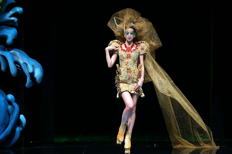 A model showcases a creation by Chinese designer Guo Pei during the Asian Couture 2012 Singapore fashion show, Singapore, Tuesday Nov. 27, 2012. (AP Photo/Wong Maye-E) Photo: Wong Maye-E, Associated Press