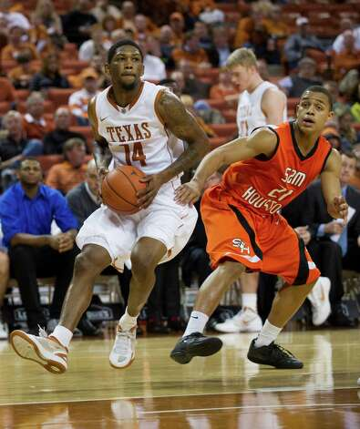 AUSTIN, TX - NOVEMBER 27:  Julien Lewis #14 of the University of Texas Longhorns drives to the basket against the Sam Houston State Bearkats on November 27, 2012 at the Frank Erwin Center in Austin, Texas. Photo: Cooper Neill, Getty Images / 2012 Getty Images
