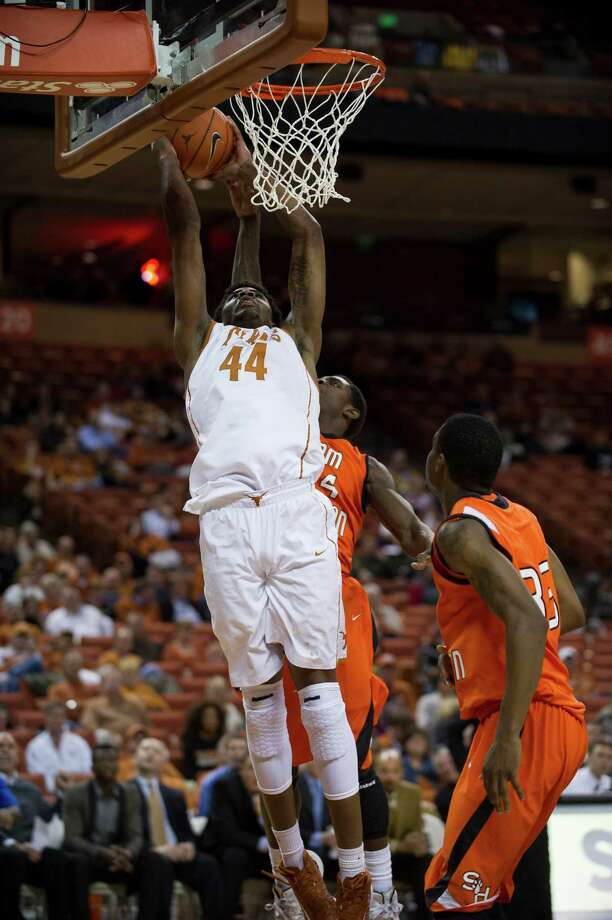 AUSTIN, TX - NOVEMBER 27:  Prince Ibeh #44 of the University of Texas Longhorns dunks the ball against the Sam Houston State Bearkats on November 27, 2012 at the Frank Erwin Center in Austin, Texas. Photo: Cooper Neill, Getty Images / 2012 Getty Images