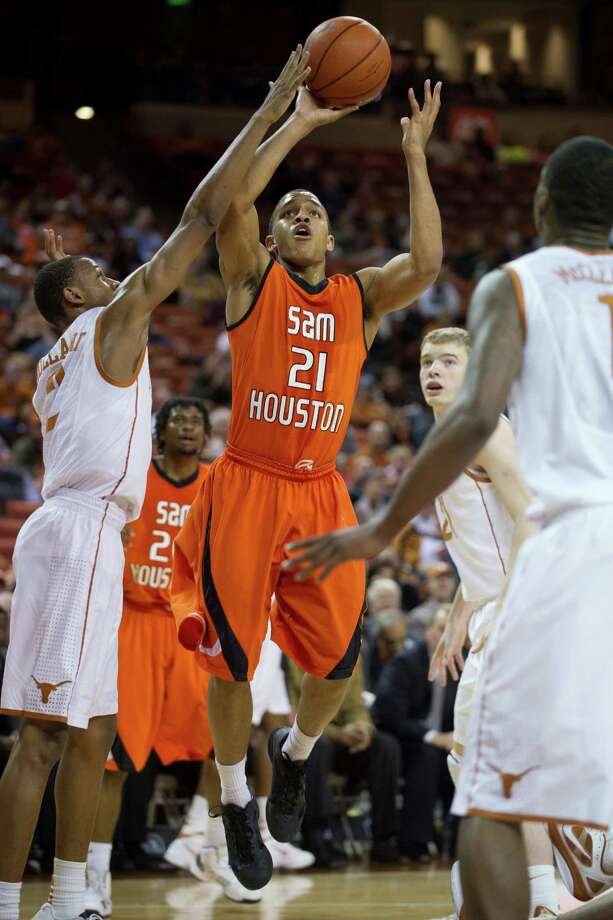AUSTIN, TX - NOVEMBER 27:  Paul Baxter #21 of the Sam Houston State Bearkats shoots the ball against the University of Texas Longhorns on November 27, 2012 at the Frank Erwin Center in Austin, Texas. Photo: Cooper Neill, Getty Images / 2012 Getty Images