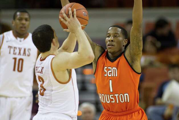 AUSTIN, TX - NOVEMBER 27:  Darius Gatson #1 of the Sam Houston State Bearkats defends against Javan Felix #3 of the University of Texas Longhorns on November 27, 2012 at the Frank Erwin Center in Austin, Texas. Photo: Cooper Neill, Getty Images / 2012 Getty Images