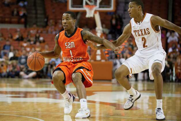 AUSTIN, TX - NOVEMBER 27:  Darius Gatson #1 of the Sam Houston State Bearkats brings the ball up the court against the University of Texas Longhorns on November 27, 2012 at the Frank Erwin Center in Austin, Texas. Photo: Cooper Neill, Getty Images / 2012 Getty Images