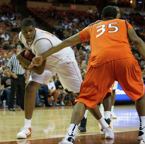 AUSTIN, TX - NOVEMBER 27:  Cameron Ridley #55 of the University of Texas Longhorns fights for a rebound against the Sam Houston State Bearkats on November 27, 2012 at the Frank Erwin Center in Austin, Texas. Photo: Cooper Neill, Getty Images / 2012 Getty Images