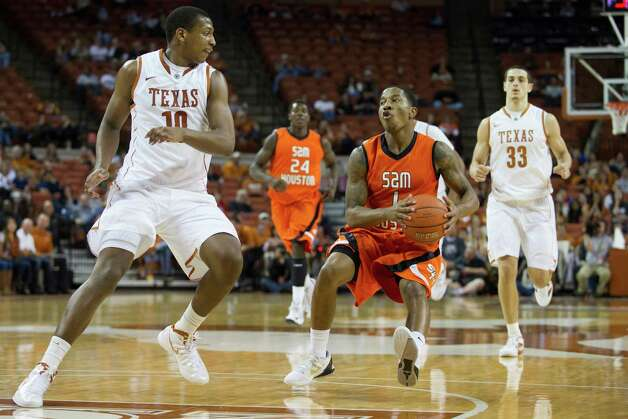 AUSTIN, TX - NOVEMBER 27:  Darius Gatson #1 of the Sam Houston State Bearkats drives to the basket against the University of Texas Longhorns on November 27, 2012 at the Frank Erwin Center in Austin, Texas. Photo: Cooper Neill, Getty Images / 2012 Getty Images