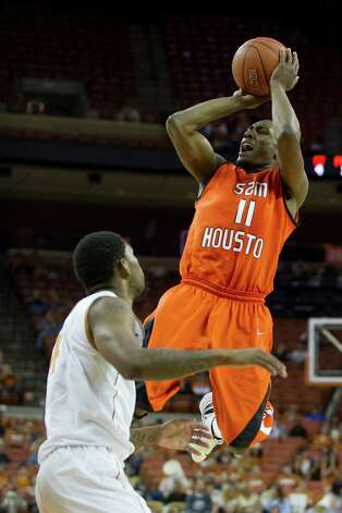 AUSTIN, TX - NOVEMBER 27:  DeMarcus Gatlin #11 of the Sam Houston State Bearkats shoots the ball against the University of Texas Longhorns on November 27, 2012 at the Frank Erwin Center in Austin, Texas. Photo: Cooper Neill, Getty Images / 2012 Getty Images