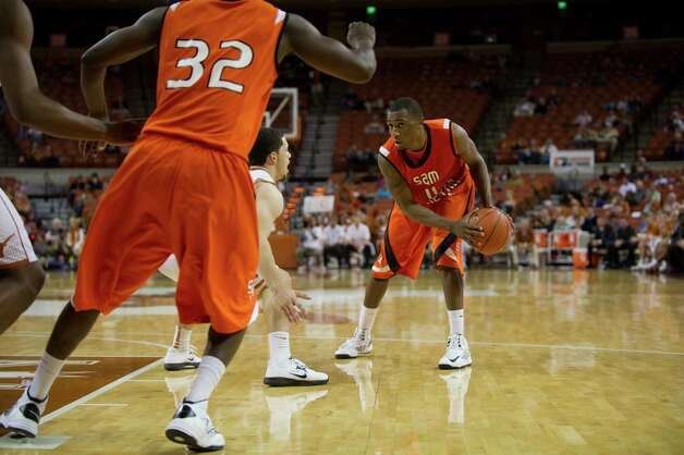AUSTIN, TX - NOVEMBER 27:  DeMarcus Gatlin #11 of the Sam Houston State Bearkats brings the ball up the court against the University of Texas Longhorns on November 27, 2012 at the Frank Erwin Center in Austin, Texas. Photo: Cooper Neill, Getty Images / 2012 Getty Images
