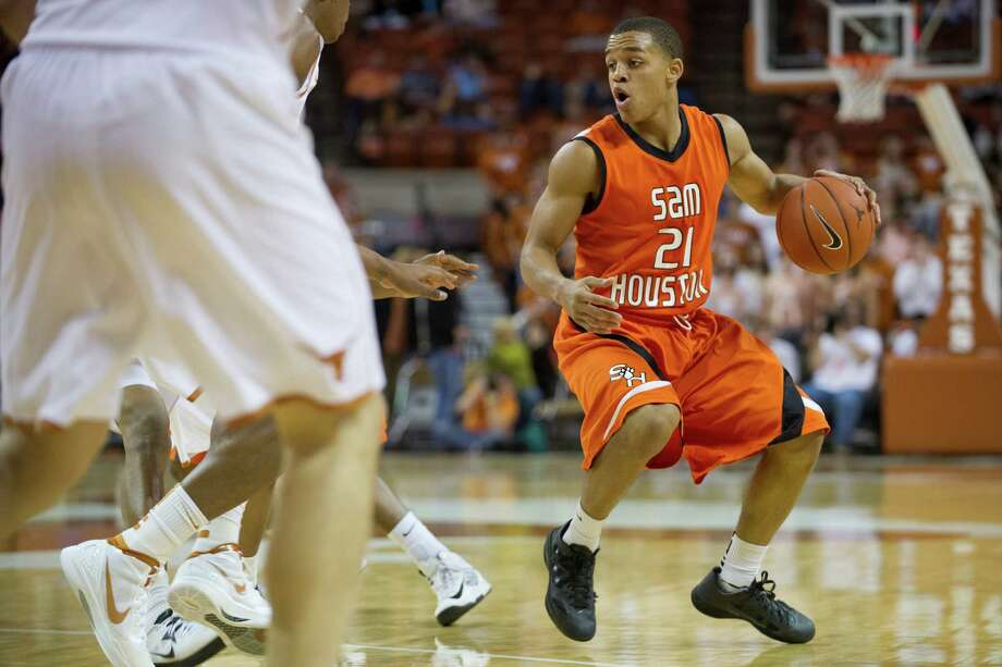 AUSTIN, TX - NOVEMBER 27:  Paul Baxter #21 of the Sam Houston State Bearkats brings the ball up the court against the University of Texas Longhorns on November 27, 2012 at the Frank Erwin Center in Austin, Texas. Photo: Cooper Neill, Getty Images / 2012 Getty Images