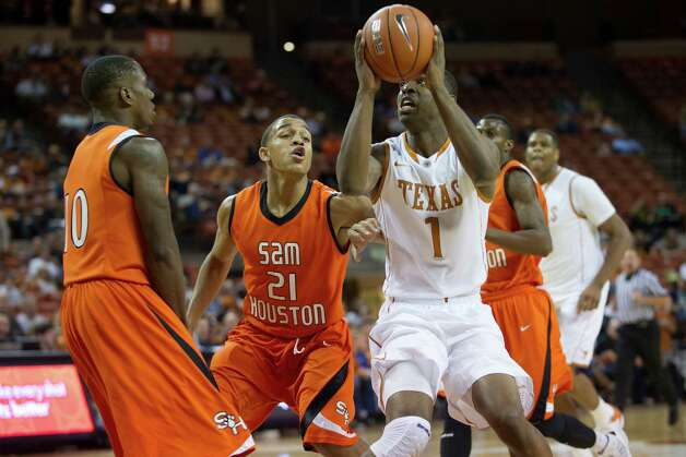 AUSTIN, TX - NOVEMBER 27:  Sheldon McClellan #1 of the University of Texas Longhorns shoots the ball against the Sam Houston State Bearkats on November 27, 2012 at the Frank Erwin Center in Austin, Texas. Photo: Cooper Neill, Getty Images / 2012 Getty Images