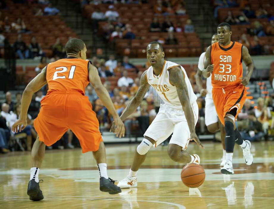 AUSTIN, TX - NOVEMBER 27:  Sheldon McClellan #1 of the University of Texas Longhorns brings the ball up the court against the Sam Houston State Bearkats on November 27, 2012 at the Frank Erwin Center in Austin, Texas. Photo: Cooper Neill, Getty Images / 2012 Getty Images