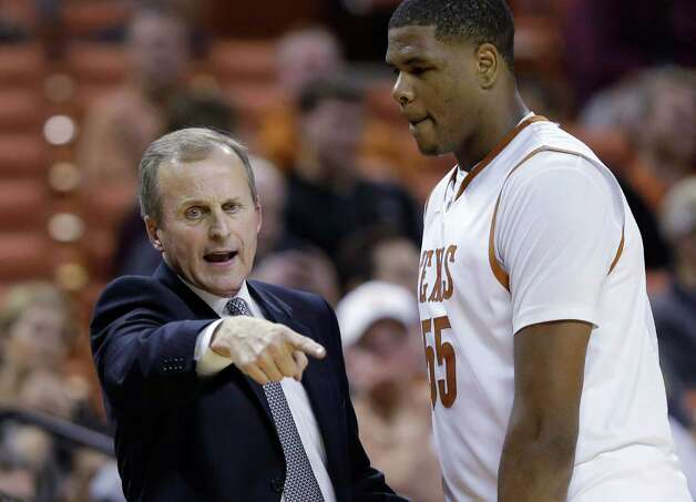 Texas coach Rick Barnes, left, talks with Cameron Ridley, right, during the second half of a NCAA college basketball game against Sam Houston State, Tuesday, Nov. 27, 2012, in Austin, Texas. (AP Photo/Eric Gay) Photo: Eric Gay, Associated Press / AP