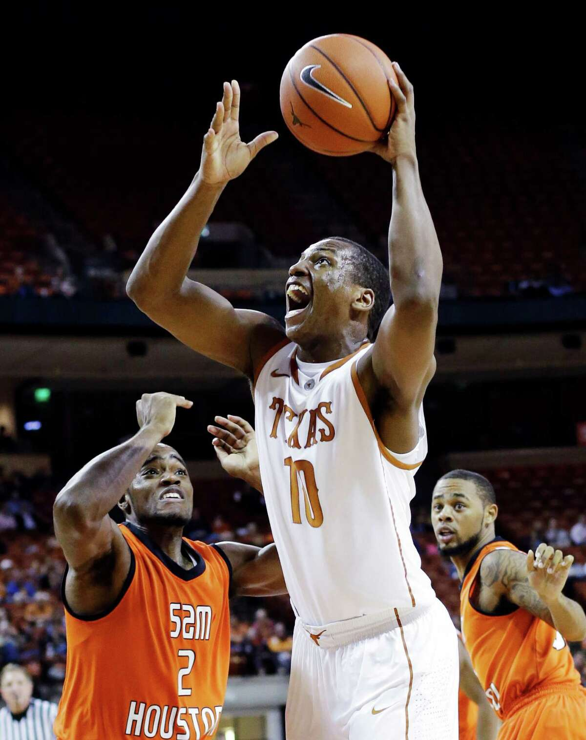 Texas' Jonathan Holmes (10) shoots over Sam Houston State's Marquel McKinney (2) during the first half of an NCAA college basketball game, Tuesday, Nov. 27, 2012, in Austin, Texas. (AP Photo/Eric Gay)