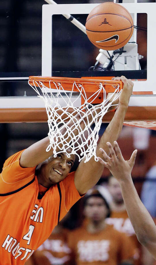 Sam Houston State's Erik Williams hangs on the rim as he tries to score against Texas during the second half of an NCAA college basketball game, Tuesday, Nov. 27, 2012, in Austin, Texas. Texas won 65-37. (AP Photo/Eric Gay) Photo: Eric Gay, Associated Press / AP