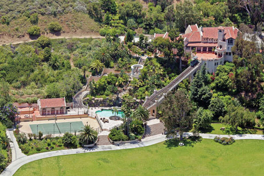 One of his Malibu properties includes a funicular to get down to the pool. (www.hauteliving.com)