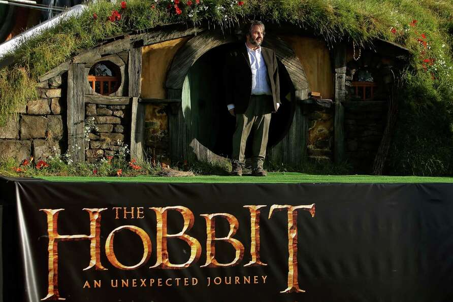 WELLINGTON, NEW ZEALAND - NOVEMBER 28:  Director Peter Jackson emerges from from a Hobbit house befo