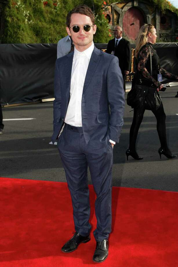 """WELLINGTON, NEW ZEALAND - NOVEMBER 28:  Elijah Wood arrives at the """"The Hobbit: An Unexpected Journey"""" World Premiere at Embassy Theatre on November 28, 2012 in Wellington, New Zealand.  (Photo by Hagen Hopkins/Getty Images) Photo: Hagen Hopkins, Getty Images / 2012 Getty Images"""