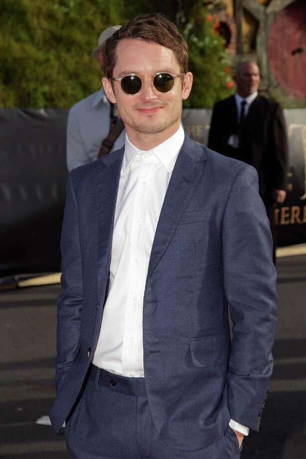 "WELLINGTON, NEW ZEALAND - NOVEMBER 28:  Elijah Wood arrives at the ""The Hobbit: An Unexpected Journey"" World Premiere at Embassy Theatre on November 28, 2012 in Wellington, New Zealand.  (Photo by Hagen Hopkins/Getty Images) Photo: Hagen Hopkins, Getty Images / 2012 Getty Images"