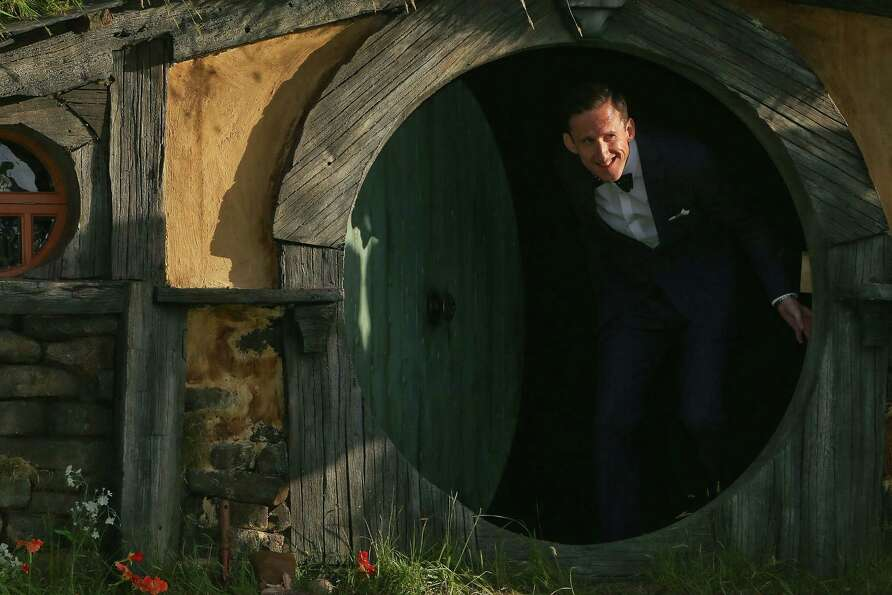 WELLINGTON, NEW ZEALAND - NOVEMBER 28:  Adam Brown who plays Ori, emerges from a Hobbit house at the