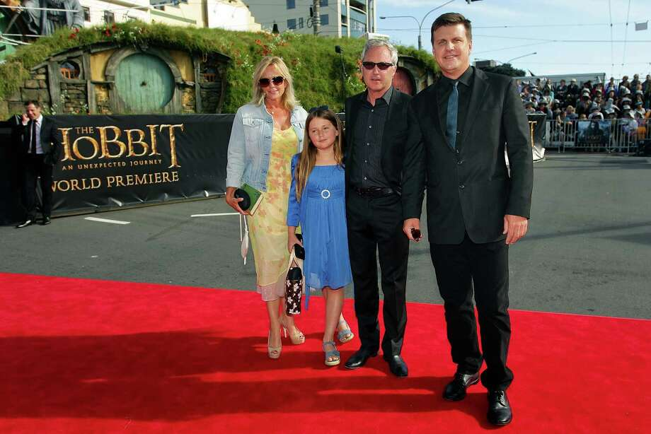 "WELLINGTON, NEW ZEALAND - NOVEMBER 28:  CEO of RealD Michael V. Lewis (R) and property developer John Darby along with wife Kristine and daughter Georgie arrive at the ""The Hobbit: An Unexpected Journey"" World Premiere at Embassy Theatre on November 28, 2012 in Wellington, New Zealand.  (Photo by Hagen Hopkins/Getty Images) Photo: Hagen Hopkins, Getty Images / 2012 Getty Images"