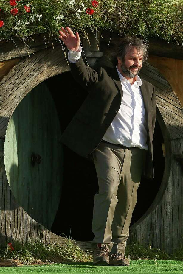 "WELLINGTON, NEW ZEALAND - NOVEMBER 28:  Director Sir Peter Jackson emerges from from a Hobbit house before delivering a speech at the ""The Hobbit: An Unexpected Journey"" World Premiere at Embassy Theatre on November 28, 2012 in Wellington, New Zealand.  (Photo by Hagen Hopkins/Getty Images) Photo: Hagen Hopkins, Getty Images / 2012 Getty Images"