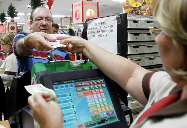 Maria Diaz, right, sells a customer Powerball tickets at a local supermarket in Hialeah, Fla.,Tuesday, Nov. 27, 2012. There has been no Powerball winner since Oct. 6, and the jackpot already has reached a record level for the game. Already over $500 million, it is the second-highest jackpot in lottery history, behind only the $656 million Mega Millions prize in March. (AP Photo/Alan Diaz) Photo: Alan Diaz