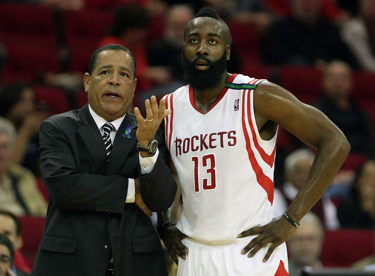 The Houston Rockets acting head coach Kelvin Sampson left, speaks with the Rockets James Harden as the Rockets play Toronto Raptors during the second quarter of NBA game action at the Toyota Center Tuesday, Nov. 27, 2012, in Houston.