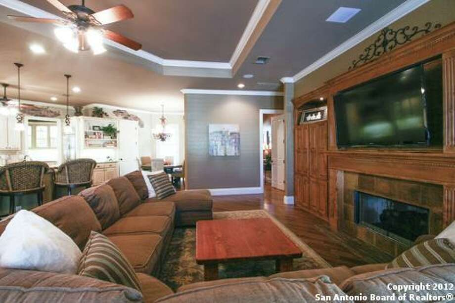 Among the living room's built-ins are a discreet fireplace and space for a large TV.