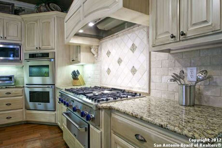 Stainless steel double ovens, a spacious stove top and a generous cooking hood provide excellent tools for the at-home chef.