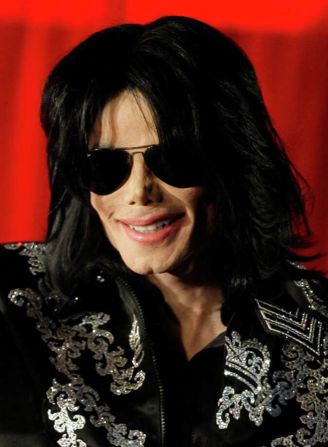 In this March 5, 2009 file photo, Michael Jackson is shown at a press conference in London. A judge rules that attorneys for the doctor charged in Michael Jackson's death cannot play footage of the singer's news conference promoting his final concerts for jurors. The judge's ruling is among his final in preparation for opening statements in the case on Tuesday Sept. 27,2011. (AP Photo/Joel Ryan, File) Photo: Ap, STF / AP2009