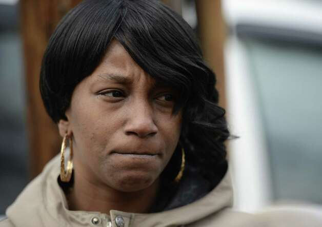 Eileen Johnson, cousin of stabbing victims, speaks to the media outside of the Albany City Court building in Albany, N.Y., on Nov 28, 2012, about alleged murderer Michael Anderson.    (Skip Dickstein/Times Union) Photo: SKIP DICKSTEIN