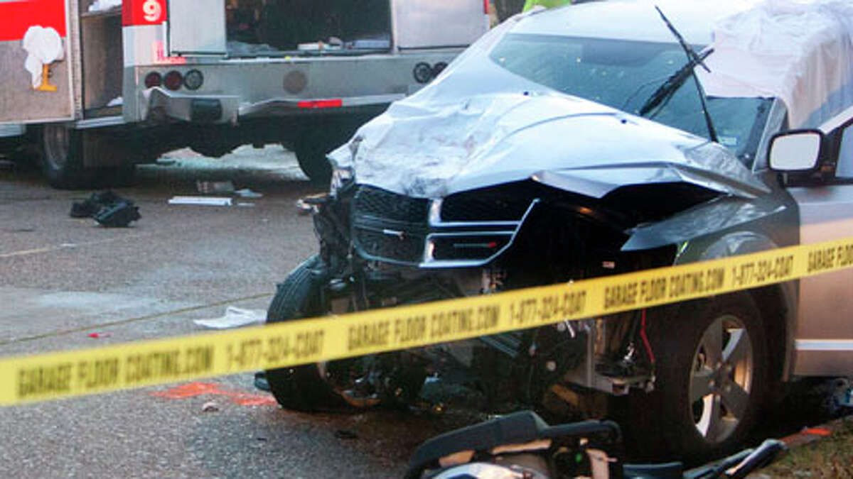 Houston police investigators work a car wreck scene on Nov. 26. There's something off about the caution tape, however. (Cody Duty / Houston Chronicle)