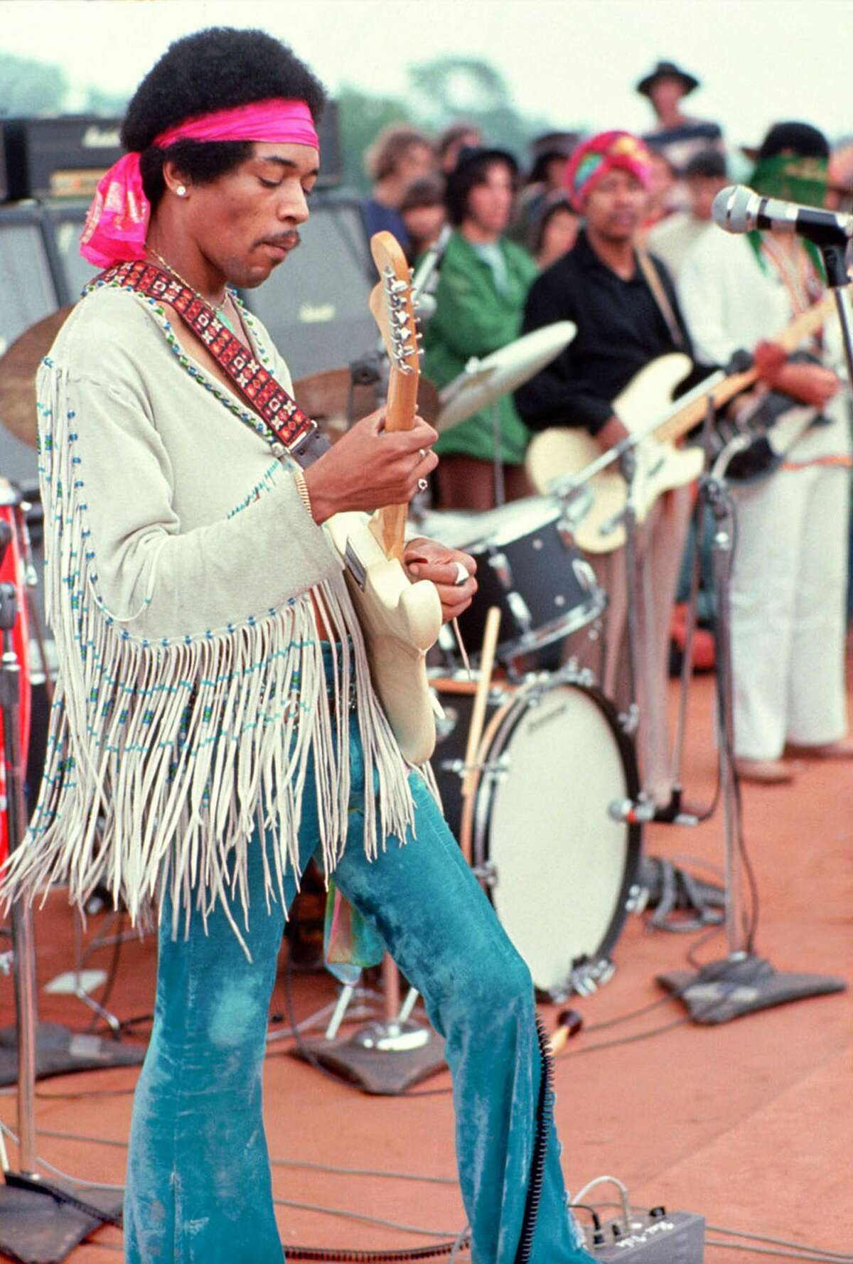 (FILES) This handout file photo by Henry Diltz shows musician Jimi Hendrix playing live at the original Woodstock festival in Bethel, New York on August 15, 1969. Hendrix's relatively short stage career with his band The Experience lasted only four years, but his musical legacy was huge, on September 18, 2010 people the world over are preparing to mark the fortieth anniversary of the death of the guitar hero who died on September 18, 2010 in london hotel room after choking on his own vomit after a lethal cocktail of Red wine and sleeping pills. AFP PHOTO/HENRY DILTZ/MORRISON HOTEL GALLERY/NEWSCOM/HO ++RESTRICTED TO EDITORIAL USE++ (Photo credit should read HENRY DILTZ/AFP/Getty Images)