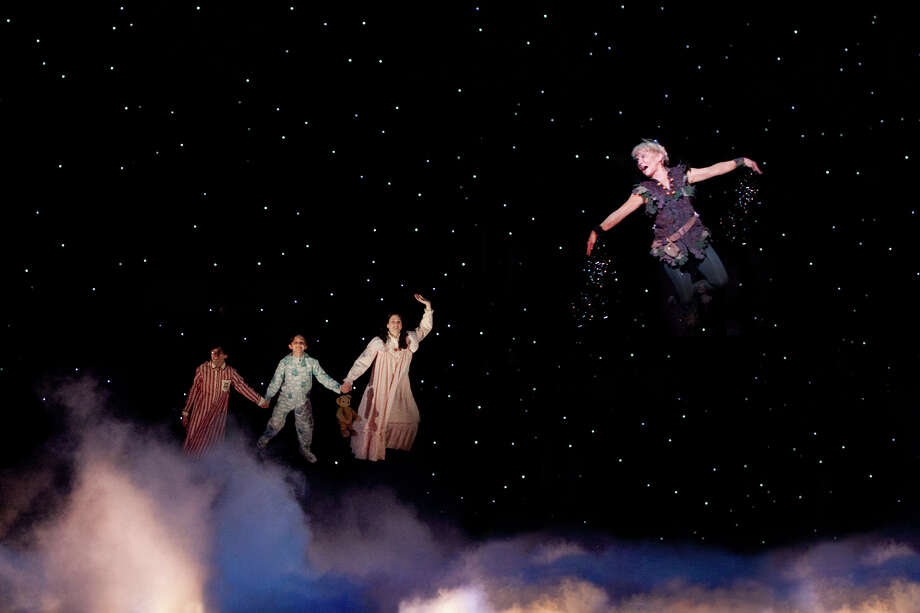 "As the title character, Cathy Rigby takes the Darling children (from  left, Cade Canon Ball, Julia Massey, Krista Buccellato) for a spin in  the stage version of ""Peter Pan."" Courtesy Isaac James Photo: Courtesy Isaac James"