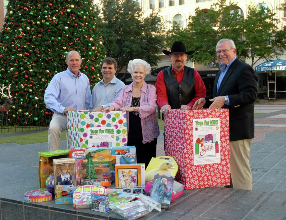Fort Bend area organizations are working together this holiday season to collect toys for Fort Bend youths. From left are: John Robson, Santa's Exchange chairman-Exchange Club of Sugar Land; Ward Pendleton, president-elect Sugar Land Rotary Club; Carolyn Tarver, Project SMILE organizer; Greg Pendley, past president Sugar Land Rotary Club; and Jack Molho, coordinator Toys for Tots Fort Bend. Photo: George Wong / Freelance
