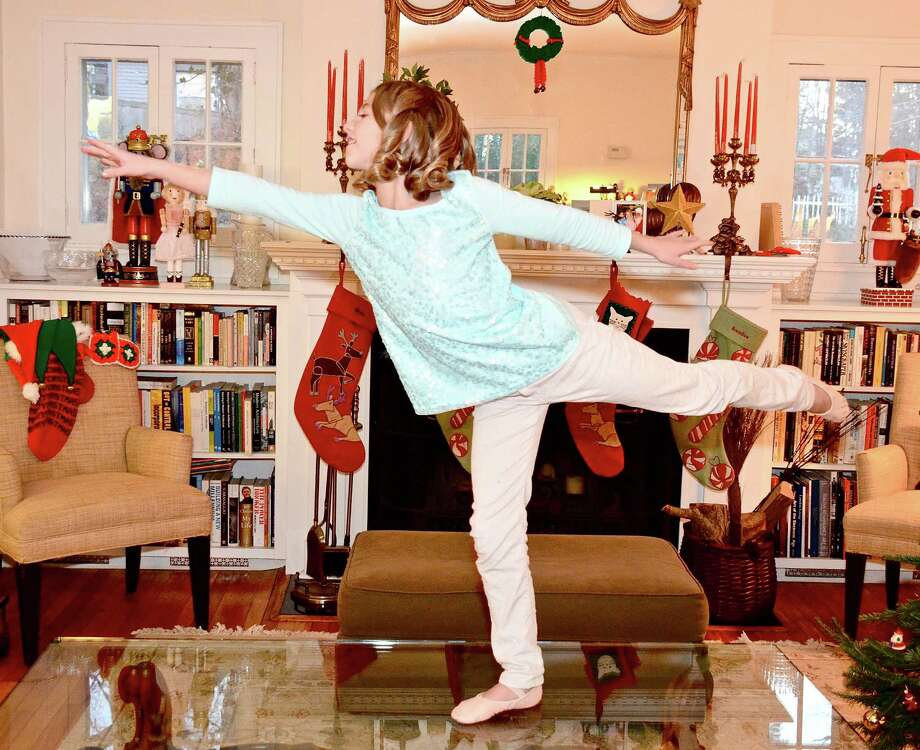 Eight-year-old Alison Enters, who is performing in The Nutcracker with the  New York Theatre Ballet this season, strikes a pose at home in Darien.  Nov. 27, 2012, Darien, Conn. Photo: Jeanna Petersen Shepard