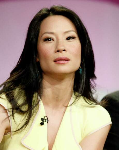 """Lucy Liu, seen in this file photo taken in Beverly Hills Calif., Thursday, July 17, 2008, is set to embrace her inner warrior. The 39-year-old actress will lend her voice to """"Afro Samurai: Resurrection,"""" a two-hour sequel to the animated series starring Samuel L. Jackson, Spike TV announced Thursday, July 24, 2008. Liu will play Sio, a seductive and sadistic mastermind out to destroy Jackson's samurai. Photo: Matt Sayles, AP / AP"""