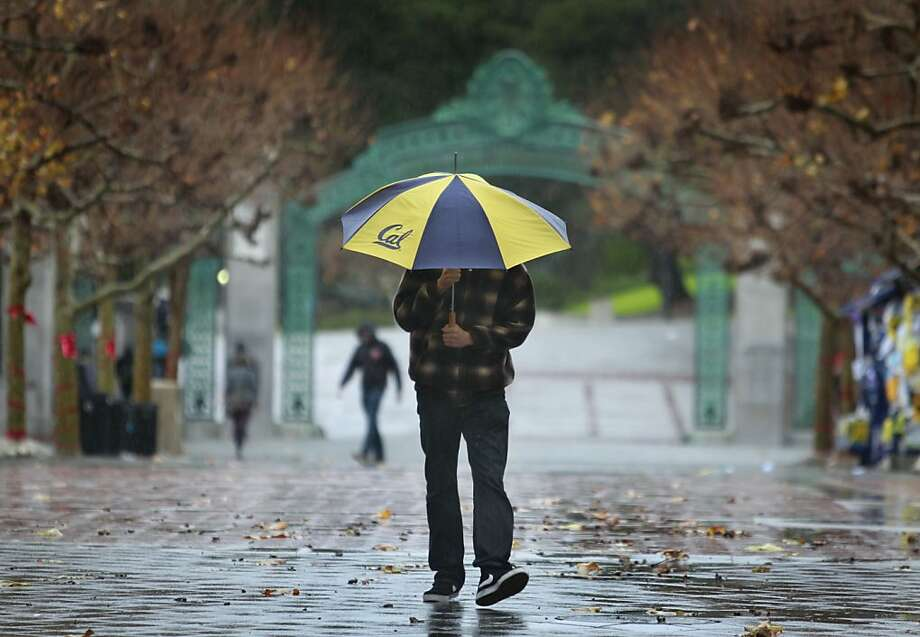 A student walks in the rain on Sproul Plaza at UC Berkeley on Wednesday, Nov. 28, 2012. Photo: Paul Chinn, The Chronicle