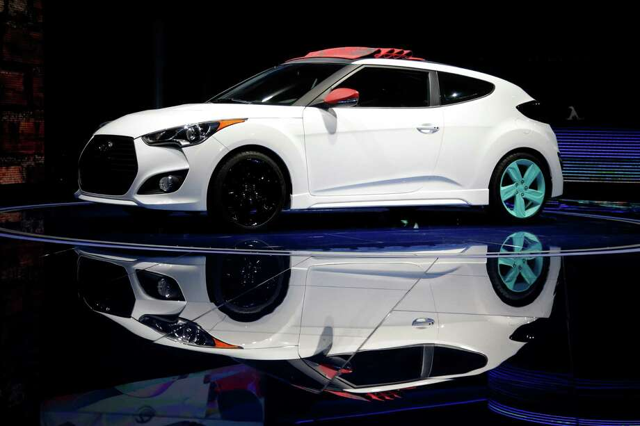 The Hyundai Veloster C3 concept is unveiled at the LA Auto Show in Los Angeles, Wednesday, Nov. 28, 2012. The annual Los Angeles Auto Show opened to the media Wednesday at the Los Angeles Convention Center. The show opens to the public on Friday, November 30. (AP Photo/Jae C. Hong) Photo: Jae C. Hong, Associated Press / AP