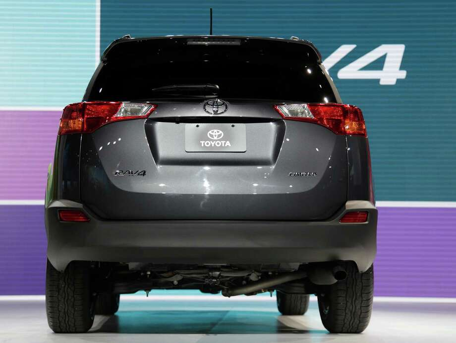 The Toyota RAV4 is shown during it's world debut at the LA Auto Show in Los Angeles, Wednesday, Nov. 28, 2012. The annual Los Angeles Auto Show opened to the media Wednesday at the Los Angeles Convention Center. The show opens to the public on Friday, November 30. (AP Photo/Chris Carlson) Photo: Chris Carlson, Associated Press / AP