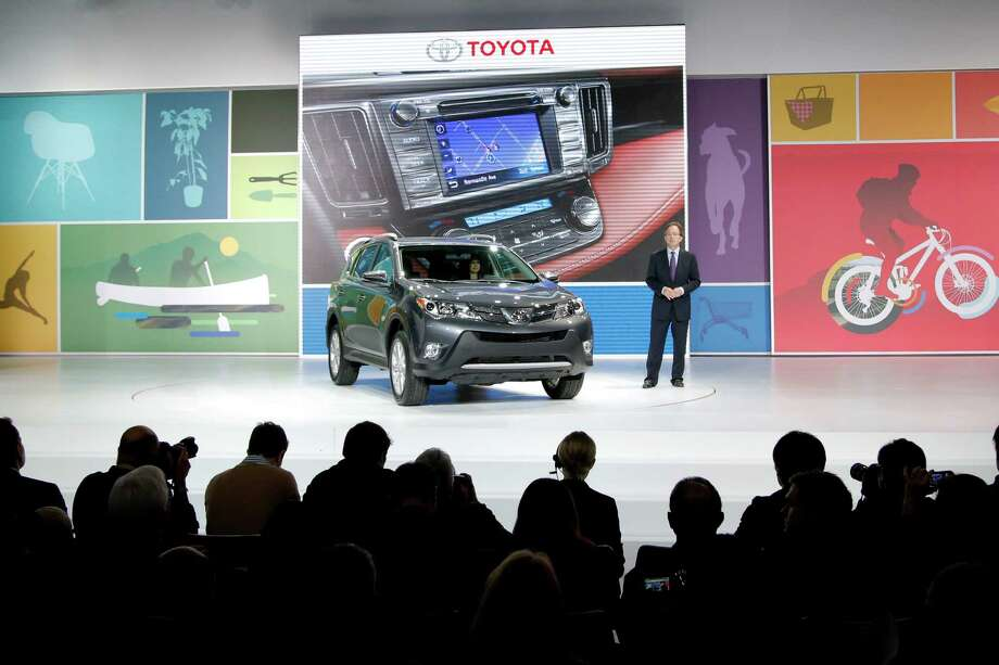The new Toyota RAV4 is unveiled at the LA Auto Show in Los Angeles, Wednesday, Nov. 28, 2012. The annual Los Angeles Auto Show opened to the media Wednesday at the Los Angeles Convention Center. The show opens to the public on Friday, November 30. (AP Photo/Jae C. Hong) Photo: Jae C. Hong, Associated Press / AP