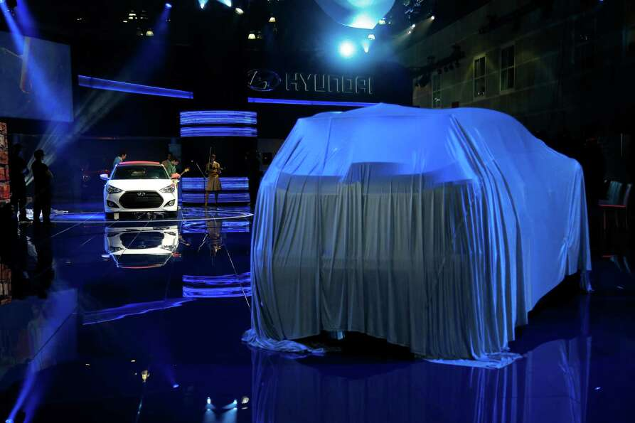 Performers rehearse at the Hyundai booth at the Los Angeles Auto Show in Los Angeles, Tuesday, Nov.
