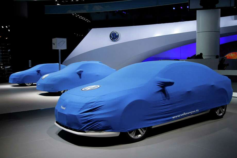 Volkswagen cars are covered at the Los Angeles Auto Show in Los Angeles, Tuesday, Nov. 27, 2012. The annual Los Angeles Auto Show opens to the public on Friday, Nov. 30 at the Los Angeles Convention Center. (AP Photo/Jae C. Hong) Photo: Jae C. Hong, Associated Press / AP