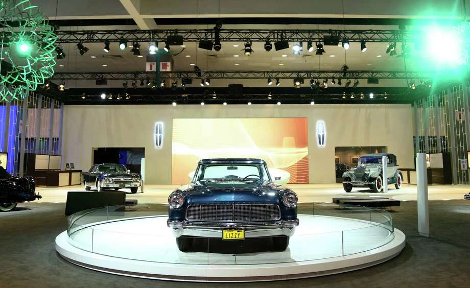 IMAGE DISTRIBUTED FOR LINCOLN - 1956 Lincoln Continental Mark II, center, is seen as part of Lincoln's Heritage on Display at the Los Angeles Auto Show press day, Wednesday, Nov. 28, 2012 in Los Angeles. This car was built especially for Elizabeth Taylor with bespoke paint and interior that matched the color of her eyes. (Photo by Matt Sayles/Invision for Lincoln/AP Images) Photo: Matt Sayles, Associated Press / Invision