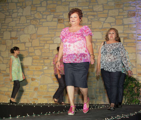 Sandra Luz Cruz, center, and Lourdes Galvan, right, wear chiffon tops and denim bottoms by designer Leticia I. Lozano. Photo: J. MICHAEL SHORT, FREELANCER / THE SAN ANTONIO EXPRESS-NEWS