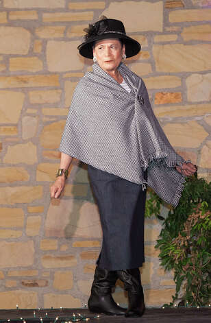 Rosa Rosales models a pencil skirt topped with a houndstooth shawl by Mary McTyre. Photo: J. Michael Short, For The Express-News / THE SAN ANTONIO EXPRESS-NEWS