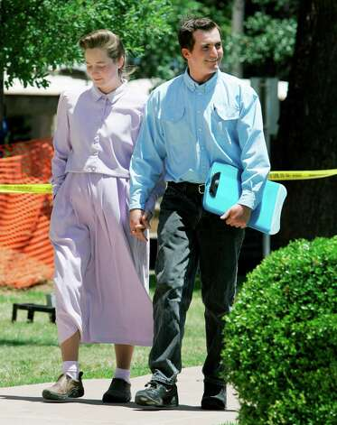 Unidentified members of the Fundamentalist Church of Jesus Christ of Latter Day Saints arrive at the Tom Green County Courthouse on May 19, 2008, in San Angelo, Texas. The parents of the more than 400 children taken from a polygamist sect's ranch on Monday began laying out their individual cases and learning what they must do to regain custody. Photo: Tony Gutierrez, AP / AP