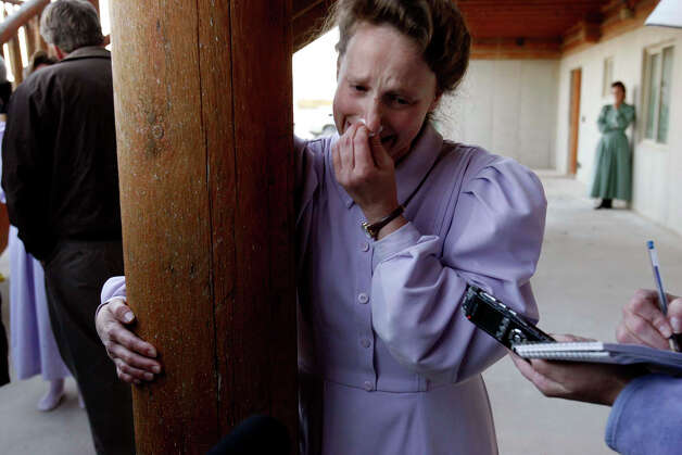 Marie, a Fundamentalist Church of Jesus Christ of Latter Day Saints woman on the Yearning for Zion  Ranch, emotionally tells her story April 14, 2008, of having their children taken into state's custody. Photo: Trent Nelson, AP / Salt Lake Tribune